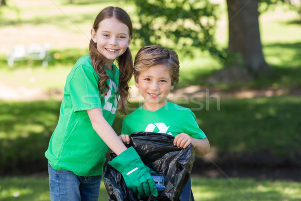 Happy siblings collecting rubbish  Stock photo © wavebreak_media
