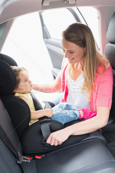 Mother securing her baby in the car seat Stock photo © wavebreak_media