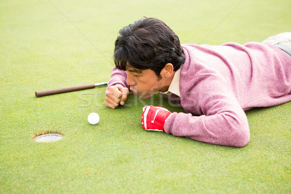 Golfista pelota agujero campo de golf deporte verde Foto stock © wavebreak_media