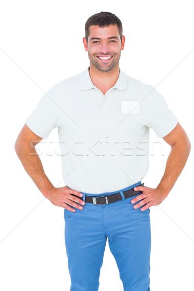 улыбаясь мужчины техник Постоянный рук бедро Сток-фото © wavebreak_media