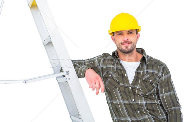 Glimlachend klusjesman ladder heldere kantoor Stockfoto © wavebreak_media