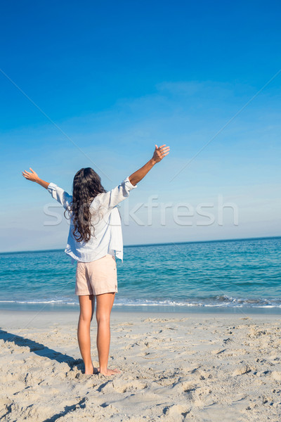 Happy woman with arms outstretched at the beach Stock photo © wavebreak_media