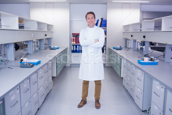 Portrait of a smiling biochemist standing with arms crossed Stock photo © wavebreak_media