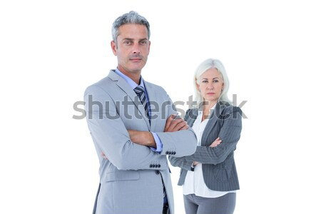 Smiling businesswoman and man with arms crossed Stock photo © wavebreak_media