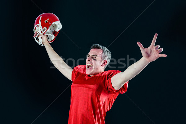 A triumph of an american football player without his helmet  Stock photo © wavebreak_media