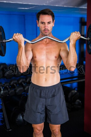 Muscular man lifting a kettlebell Stock photo © wavebreak_media