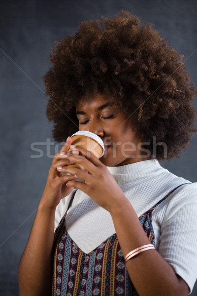 Close up of woman drinking coffee against wall Stock photo © wavebreak_media