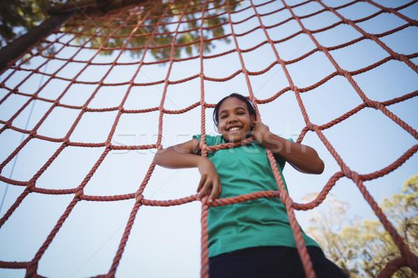Portret happy girl wspinaczki netto boot Zdjęcia stock © wavebreak_media