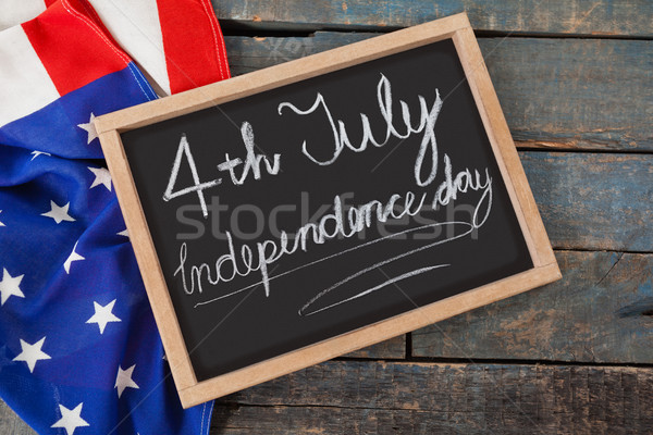 American flag and slate with text 4th july independence day Stock photo © wavebreak_media