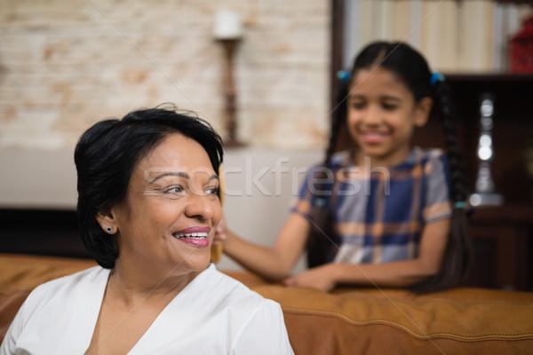 Smiling mature woman sitting on sofa Stock photo © wavebreak_media