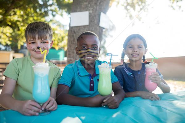 Glimlachend kinderen gezicht verf dranken park Stockfoto © wavebreak_media