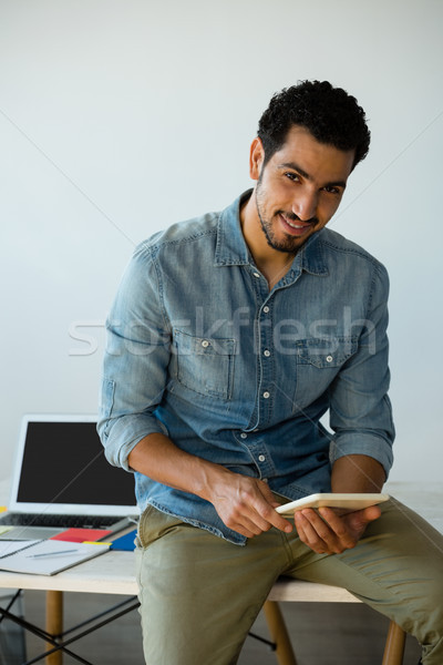Portrait of man using digital tablet on desk at office Stock photo © wavebreak_media
