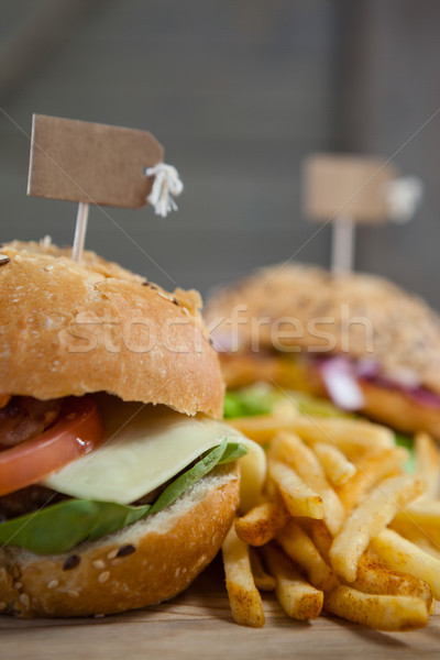 Hamburger with tag and french fries on wooden table Stock photo © wavebreak_media