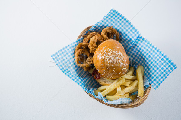 Burger patatine fritte cipolla anelli basket Foto d'archivio © wavebreak_media