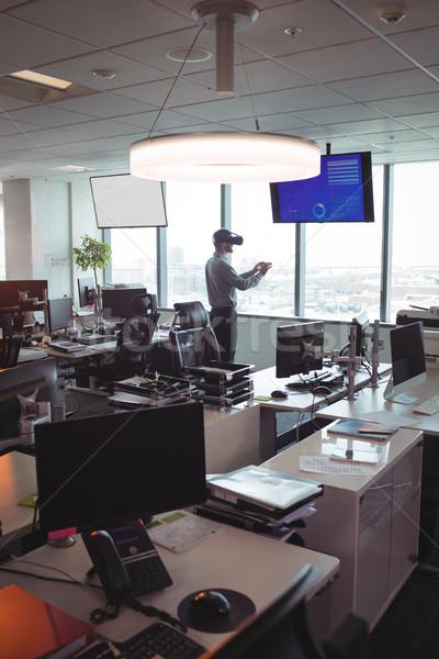 Businessman using virtual reality technology at office Stock photo © wavebreak_media