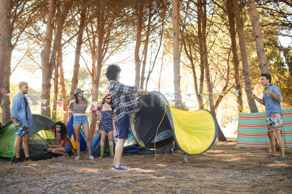Young friends setting up their tents at countryside Stock photo © wavebreak_media