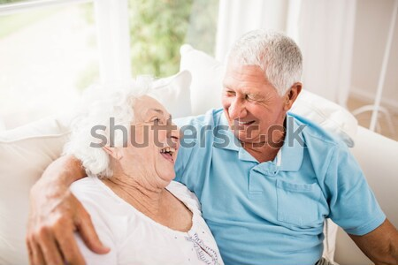 Smiling senior women with hands clasped looking away Stock photo © wavebreak_media