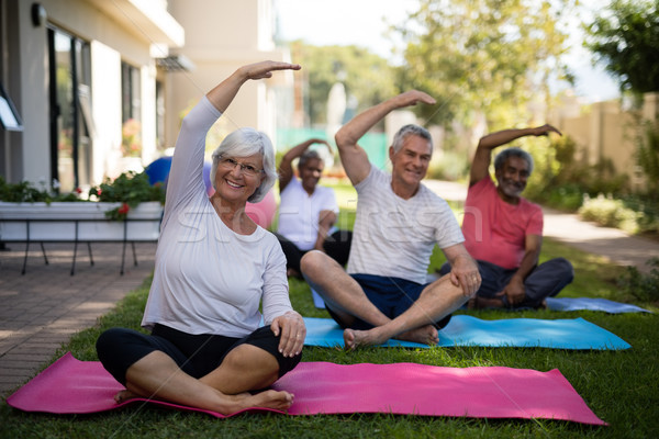 Senior people exercising with hands raised Stock photo © wavebreak_media