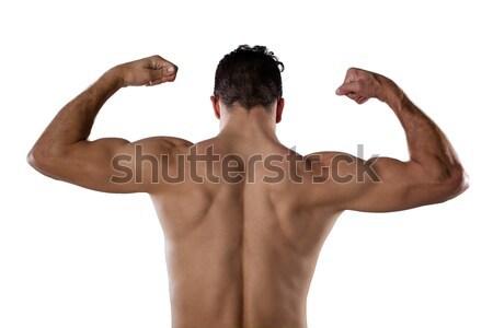 Esportes pessoa músculos em pé branco Foto stock © wavebreak_media
