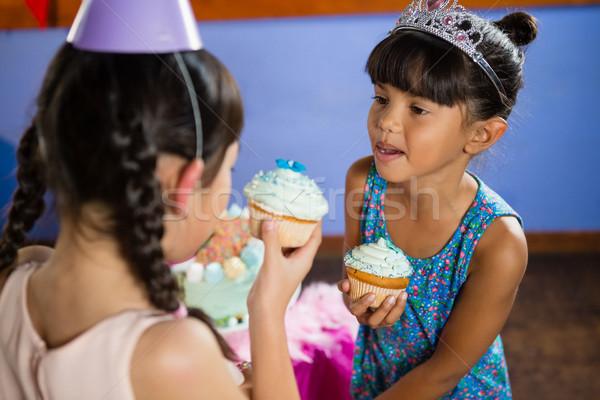 Kids having cupcake during birthday party Stock photo © wavebreak_media