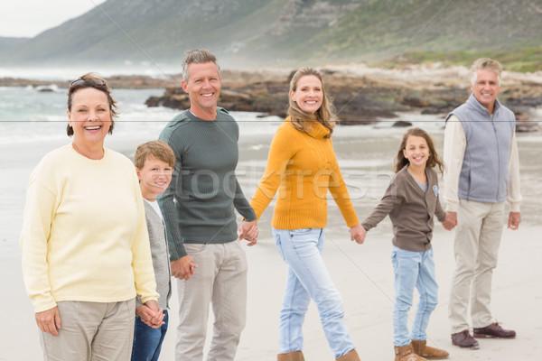 Többgenerációs család összes együtt tengerpart lány férfi Stock fotó © wavebreak_media