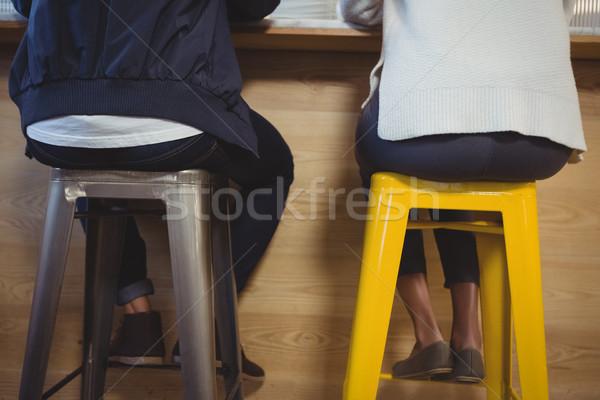 Low section of couple sitting on stools Stock photo © wavebreak_media