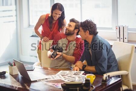 Man assisting woman in molding clay Stock photo © wavebreak_media
