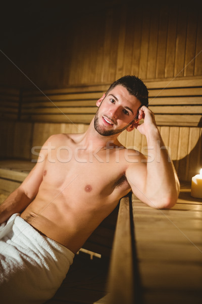Człowiek posiedzenia wewnątrz sauna spa szczęśliwy Zdjęcia stock © wavebreak_media
