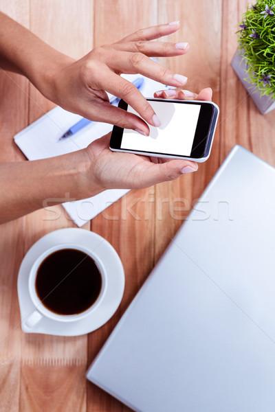 Kobiecy ręce smartphone kawy notebooka laptop Zdjęcia stock © wavebreak_media