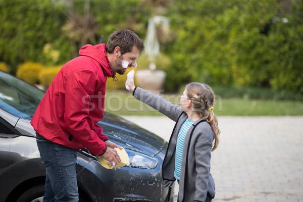 Teenage girl and father having fun Stock photo © wavebreak_media