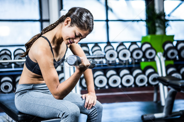 筋肉の 女性 ダンベル 座って ベンチ ストックフォト © wavebreak_media