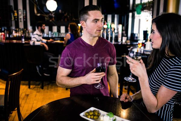 Couple having an aperitif with wine Stock photo © wavebreak_media