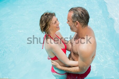 Sevimli çift oturma kenar havuz adam Stok fotoğraf © wavebreak_media