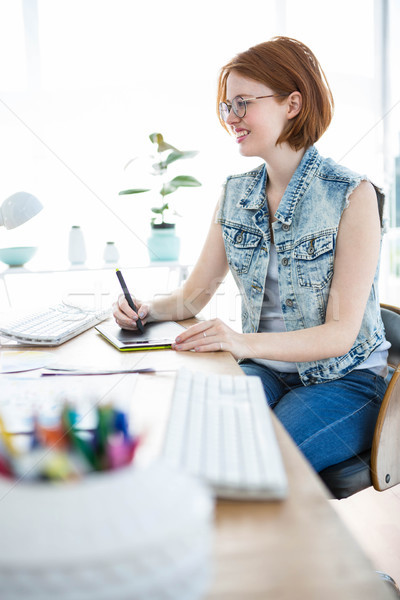smiling hipster business woman writing on her tablet Stock photo © wavebreak_media