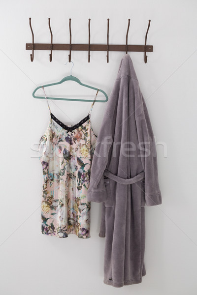 Bathrobe and nightwear hanging on hook Stock photo © wavebreak_media