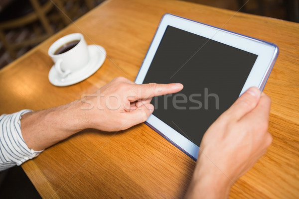 Masculine hands holding tablet Stock photo © wavebreak_media