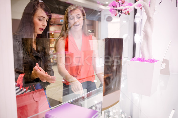 Two beautiful women selecting a wrist watch Stock photo © wavebreak_media