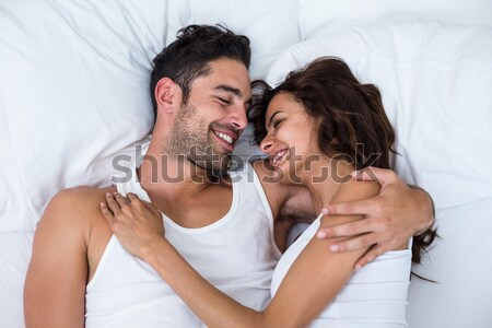 Wife kissing and embracing husband on bed Stock photo © wavebreak_media