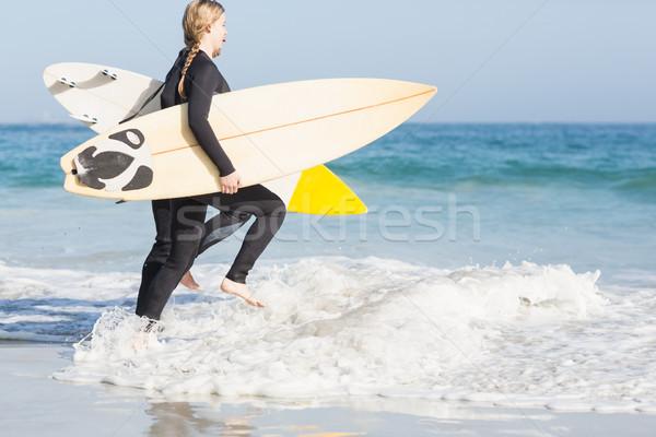 女性 サーフボード を実行して 海 ビーチ ストックフォト © wavebreak_media