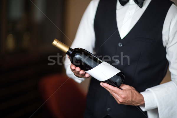 Waiter presenting red wine Stock photo © wavebreak_media