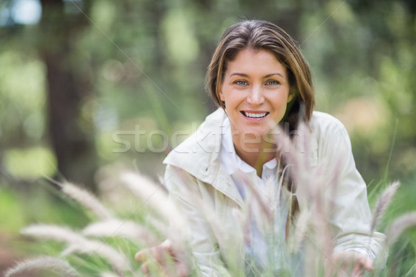 Portrait of beautiful woman crouching  Stock photo © wavebreak_media