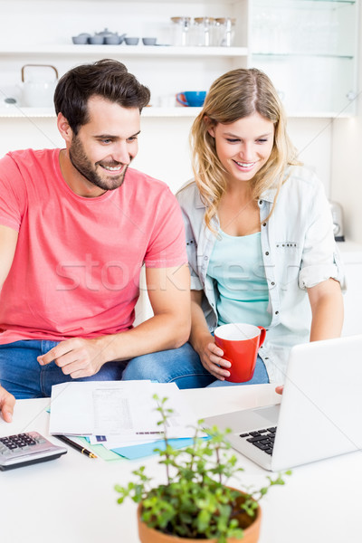 Young couple using laptop while checking a bills Stock photo © wavebreak_media
