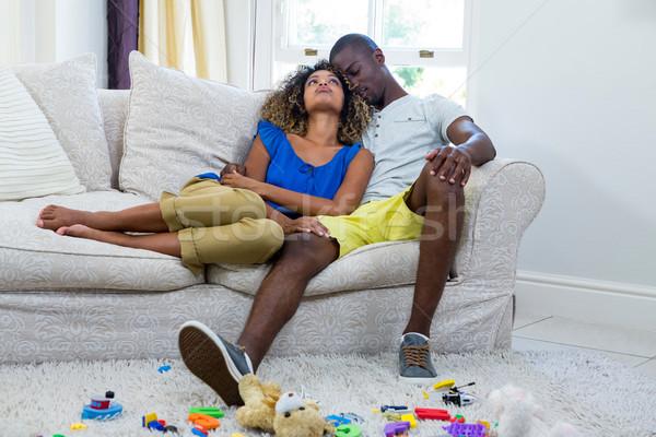Pár átkarol ül kanapé nappali otthon Stock fotó © wavebreak_media