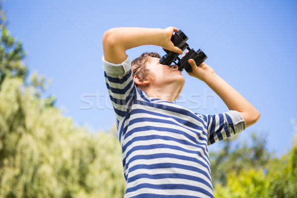 Low angle view of a child looking something with binoculars Stock photo © wavebreak_media