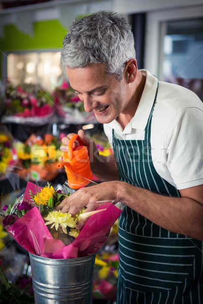 мужчины флорист цветы лейка Сток-фото © wavebreak_media