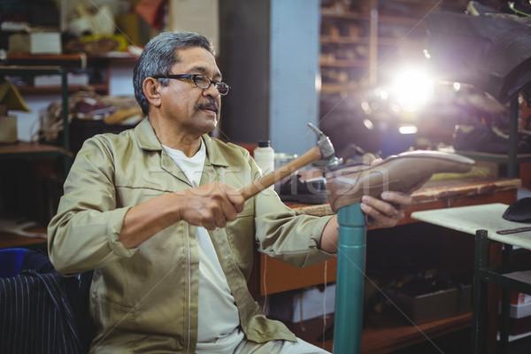 Shoemaker hammering on a shoe Stock photo © wavebreak_media