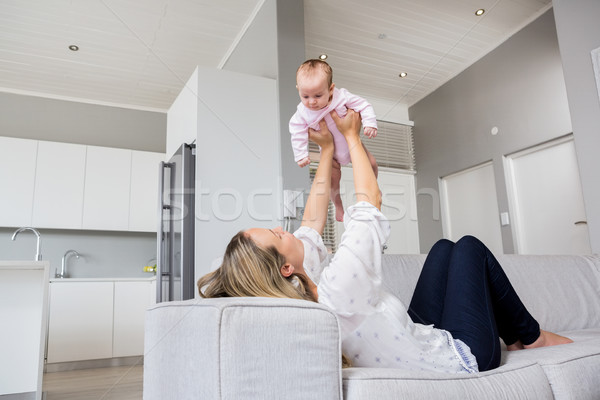 Mother playing with her baby Stock photo © wavebreak_media