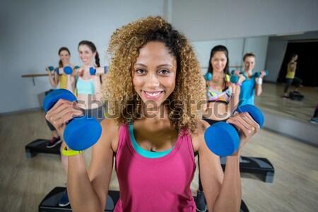 Group of fitness team standing in fitness studio Stock photo © wavebreak_media