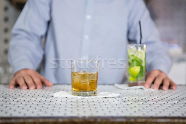 Glass of whisky on bar counter Stock photo © wavebreak_media