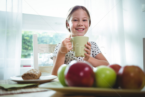 Smiling girl having coffee Stock photo © wavebreak_media